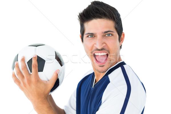 Boldog futballista kék tart labda fehér Stock fotó © wavebreak_media