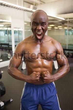 ストックフォト: 笑みを浮かべて · シャツを着ていない · 筋肉の · 男 · ジム · 肖像