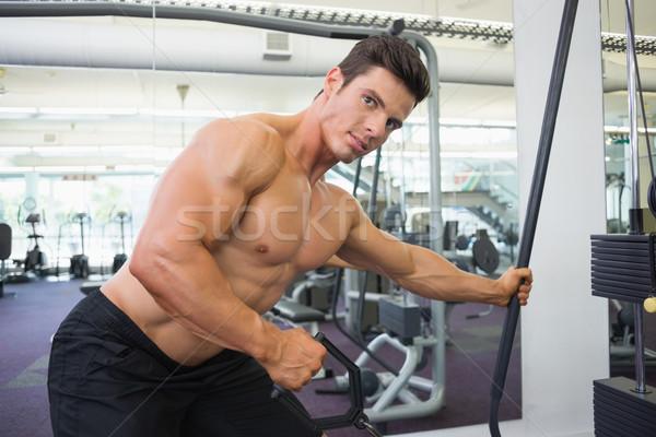 A torso nudo muscolare uomo resistenza band palestra Foto d'archivio © wavebreak_media