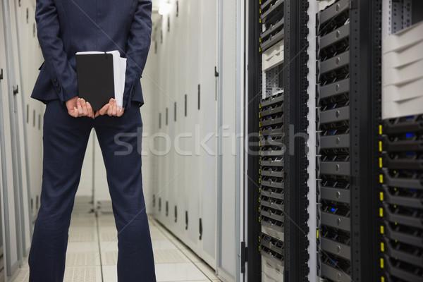 Technician standing in server hallway Stock photo © wavebreak_media