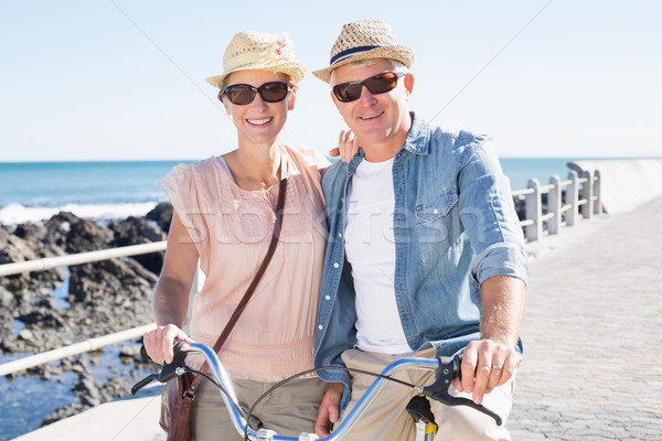 Happy casual couple going for a bike ride on the pier Stock photo © wavebreak_media