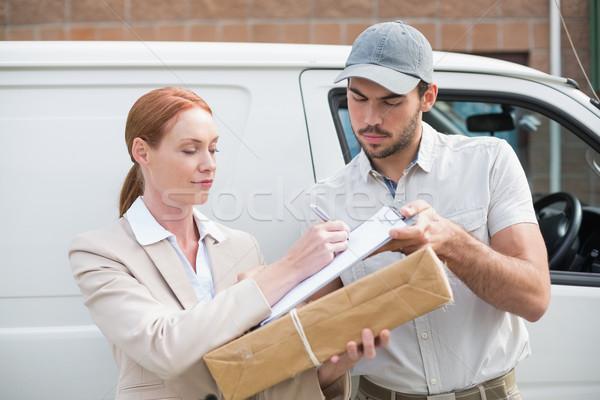 Delivery driver handing parcel to customer outside van Stock photo © wavebreak_media