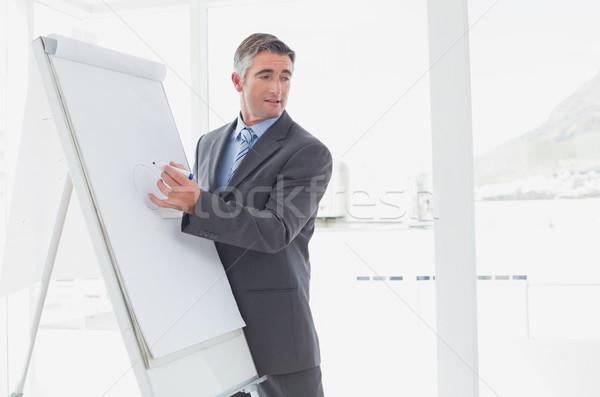 Businessman giving a presentation Stock photo © wavebreak_media