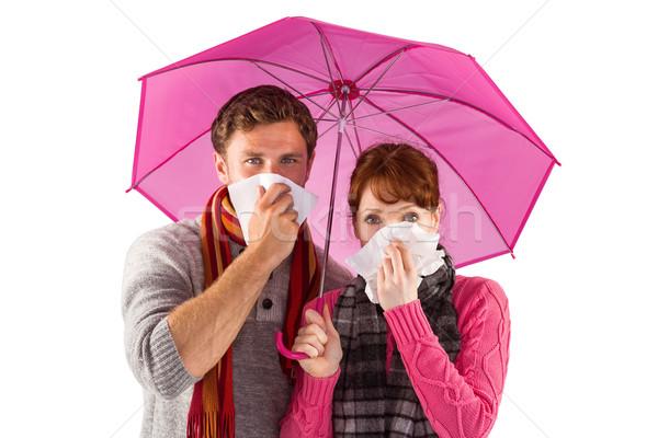 Couple standing underneath an umbrella Stock photo © wavebreak_media