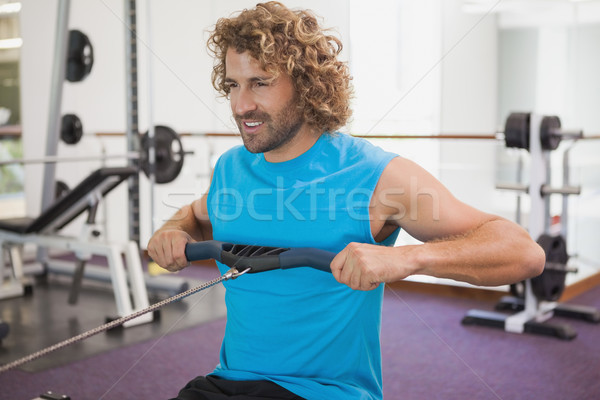 Hombre guapo resistencia banda gimnasio guapo joven Foto stock © wavebreak_media