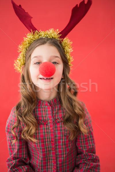 Bambina indossare rosso naso bambino Foto d'archivio © wavebreak_media