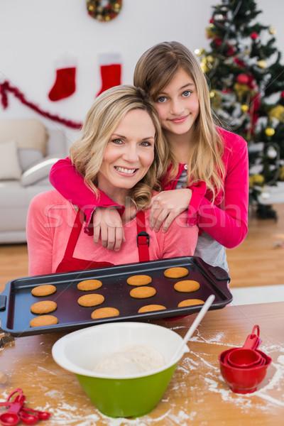 Dziewczynka christmas cookie domu Zdjęcia stock © wavebreak_media