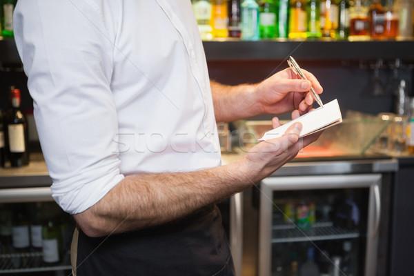 Garçom ordem bloco de notas bar trabalhando Foto stock © wavebreak_media