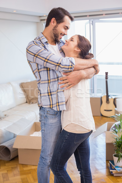 Cute couple hugging and smiling  Stock photo © wavebreak_media