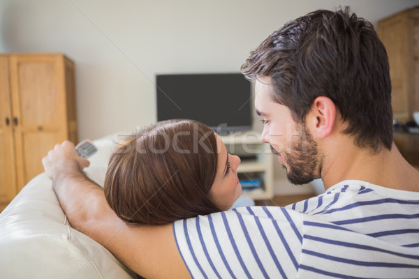 Cute couple watching tv on the couch Stock photo © wavebreak_media