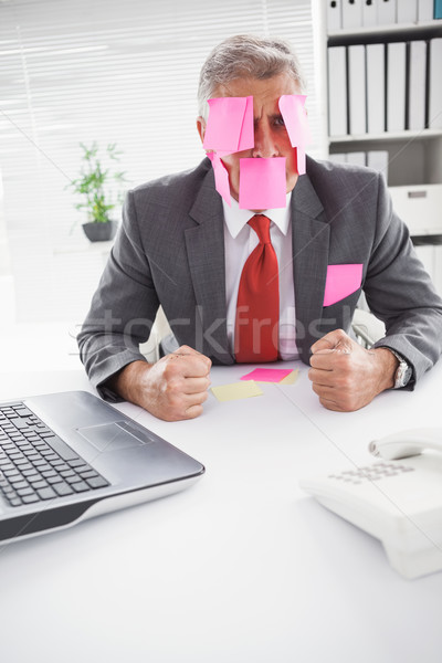 Overwhelmed businessman with sticky notes on head Stock photo © wavebreak_media