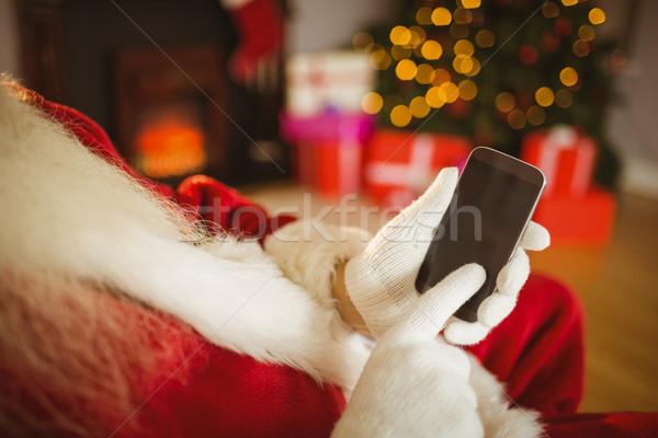 Mikulás megérint okostelefon karácsony otthon nappali Stock fotó © wavebreak_media