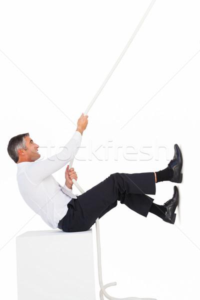Empresario sesión cuerda blanco negocios Foto stock © wavebreak_media