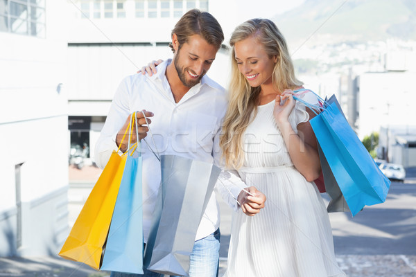 Cute couple looking at their shopping purchases Stock photo © wavebreak_media