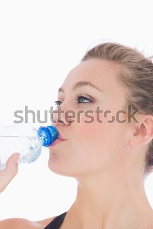 Stock photo: Pretty blonde using an asthma inhaler