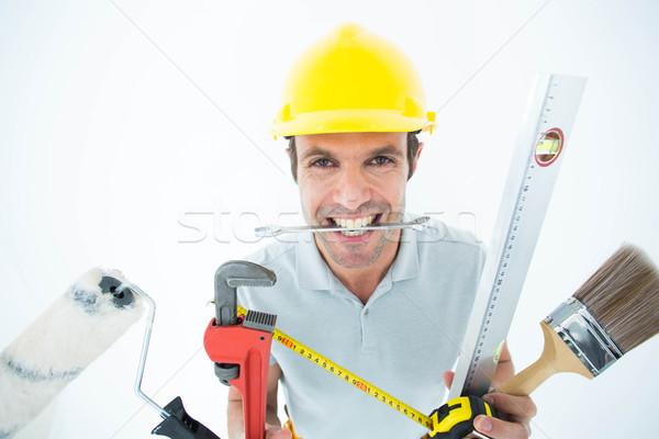 Boldog munkás különböző felszerlés portré fehér Stock fotó © wavebreak_media