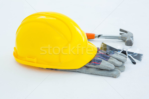 Protective gloves with hammer, glasses and yellow hard hat Stock photo © wavebreak_media