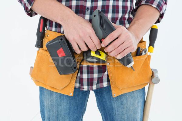 Male repairman holding drill machine Stock photo © wavebreak_media
