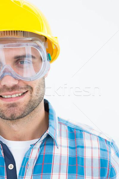 Repairman wearing protective glasses and hard hat Stock photo © wavebreak_media