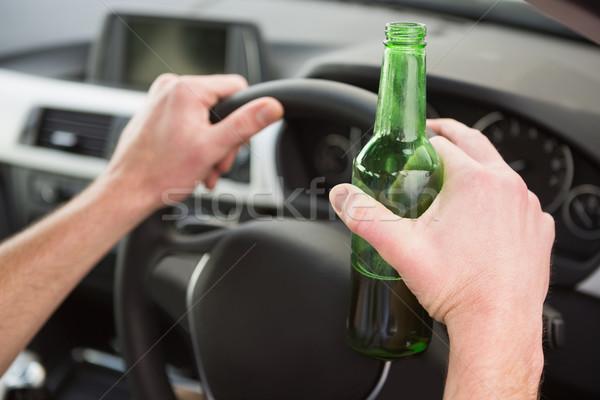 Homem potável cerveja condução carro estrada Foto stock © wavebreak_media