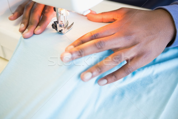 Close up of student using sewing machine Stock photo © wavebreak_media