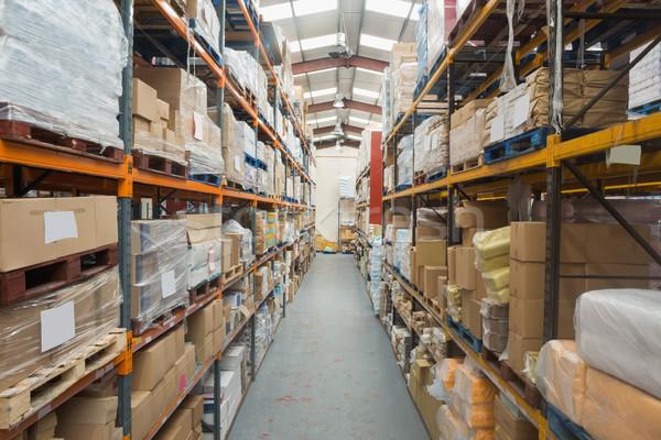 Prateleiras caixas armazém negócio indústria Foto stock © wavebreak_media