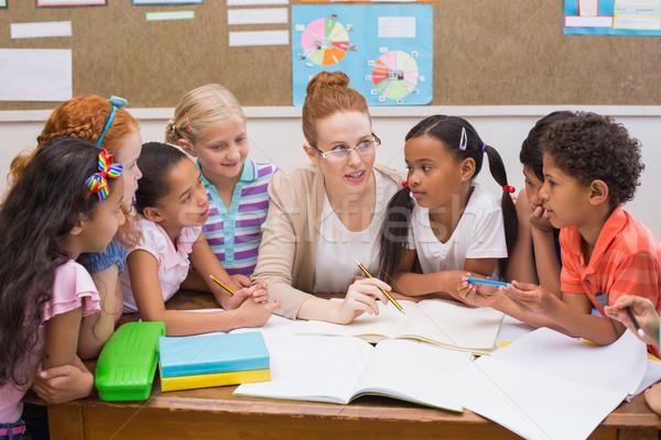 Stock fotó: Tanár · iskolás · dolgozik · asztal · együtt · általános · iskola