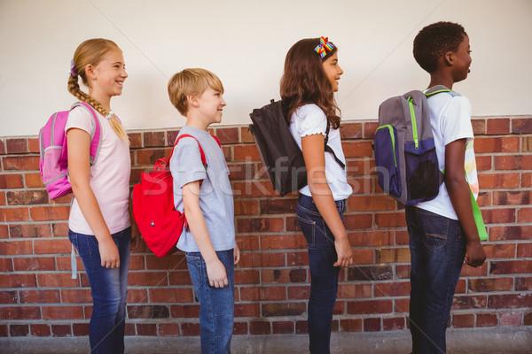 Szkoły dzieci stałego korytarz widok z boku student Zdjęcia stock © wavebreak_media