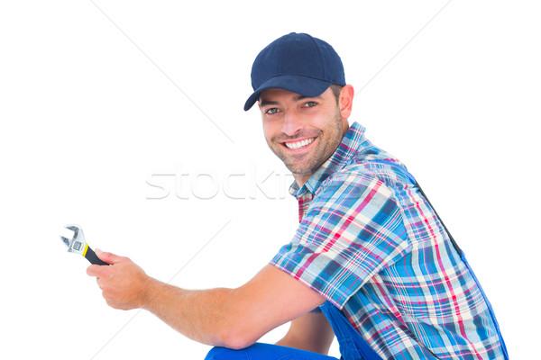 Portrait of happy handyman holding wrench Stock photo © wavebreak_media