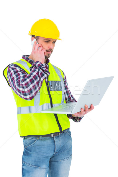 Handyman on the phone holding laptop  Stock photo © wavebreak_media