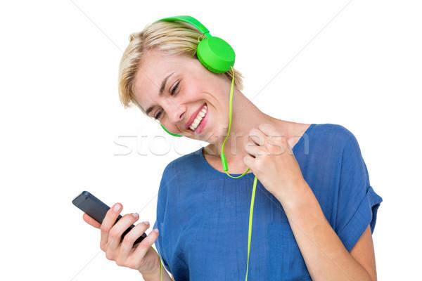Mutlu sarışın kadın dinleme müzik cep telefonu beyaz Stok fotoğraf © wavebreak_media