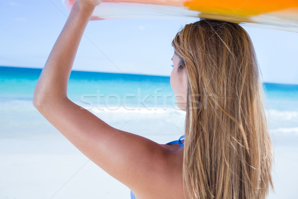 Bastante mulher loira surfar conselho praia Foto stock © wavebreak_media