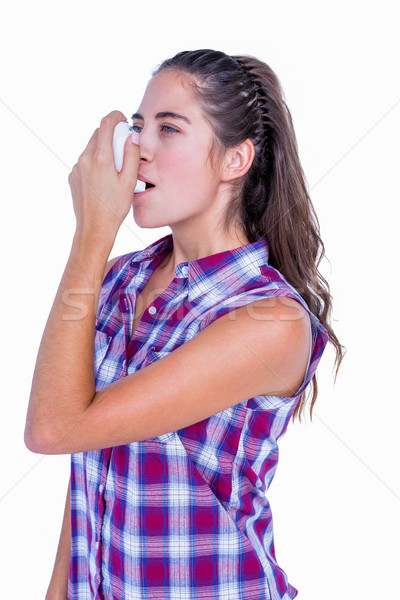 Pretty brunette woman using asthma inhaler  Stock photo © wavebreak_media