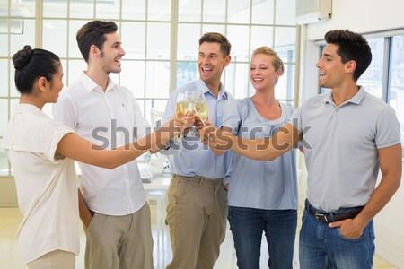 Smiling business team putting their hands together Stock photo © wavebreak_media