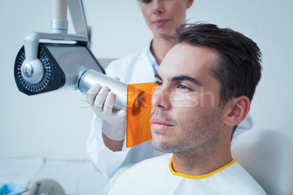 Serious young man undergoing dental checkup Stock photo © wavebreak_media