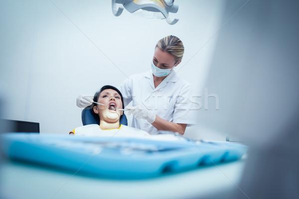 Female dentist examining womans teeth Stock photo © wavebreak_media