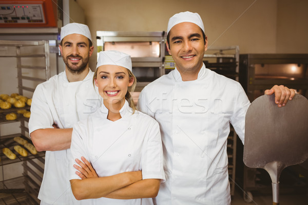 Team glimlachend camera commerciële keuken restaurant Stockfoto © wavebreak_media