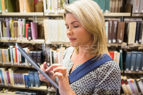 Mature student using tablet in library Stock photo © wavebreak_media