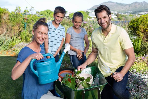 Happy young family gardening together Stock photo © wavebreak_media