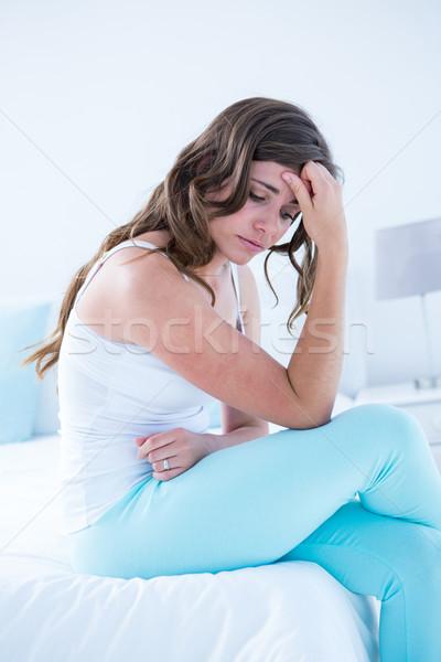Aantrekkelijke vrouw maag pijn home slaapkamer huis Stockfoto © wavebreak_media