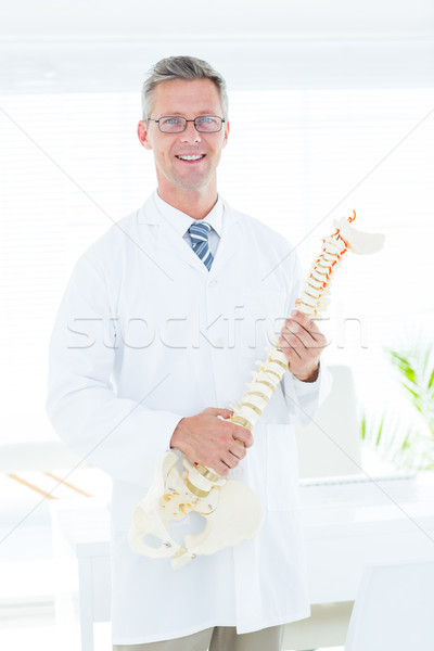 Doctor showing anatomical spine Stock photo © wavebreak_media