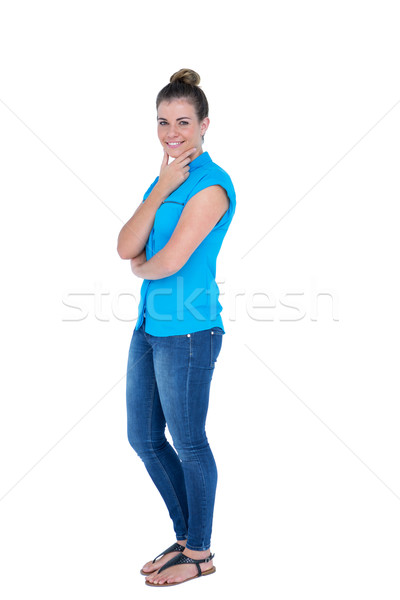 Happy pretty casual brunette looking at camera with hands on chi Stock photo © wavebreak_media