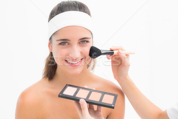 Hand applying blush to beautiful woman Stock photo © wavebreak_media
