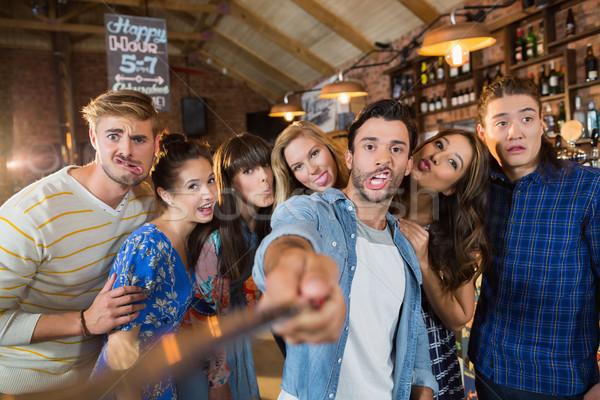 Cheerful friends taking selfie in pub Stock photo © wavebreak_media