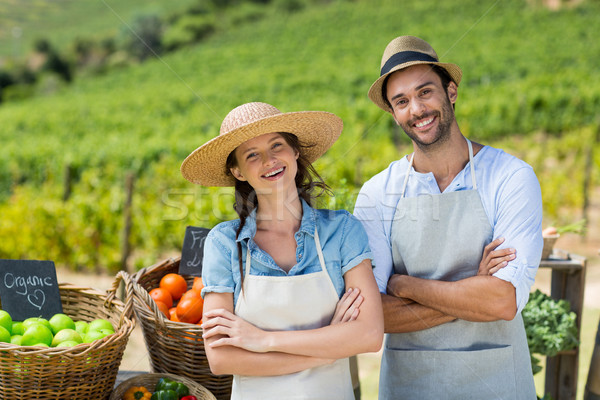 Portrait of happy couple with arms crossed at farm Stock photo © wavebreak_media