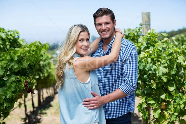 Portrait of smiling young couple embracing at vineyard Stock photo © wavebreak_media