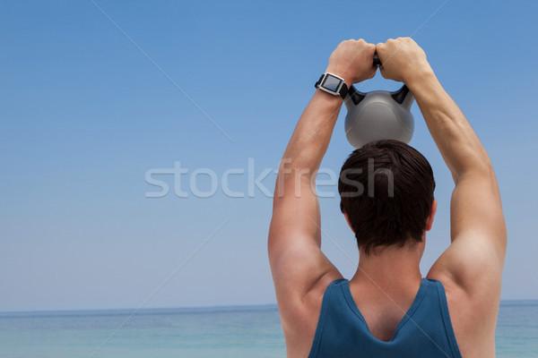 вид сзади человека гири пляж Постоянный Сток-фото © wavebreak_media