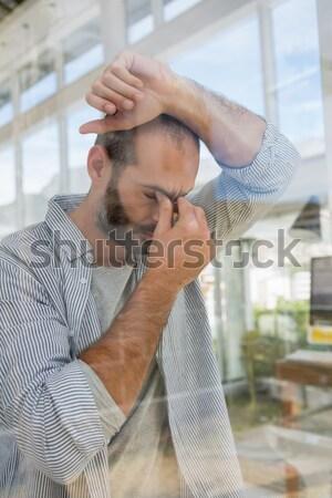 Mosolyog férfi megnyugtató függőágy portré tengerpart Stock fotó © wavebreak_media
