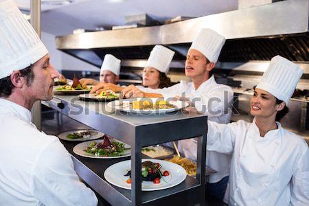 Waitress taking food dishes from order station Stock photo © wavebreak_media