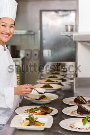 Chef presenting his food plates Stock photo © wavebreak_media